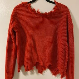 Cropped, distressed style sweater